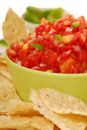 Freshly made tortilla chips with a corn and tomato salsa with limes Stock Photo - 7119856