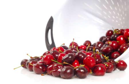 bing: Freshly washed organic Bing Cherries in a colander Stock Photo