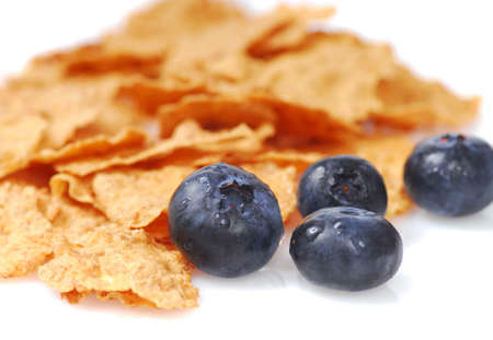 Crunchy bran cereal with fresh organic blueberries photo