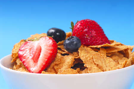 fortified: Crispy bran flakes with strawberries and blueberries