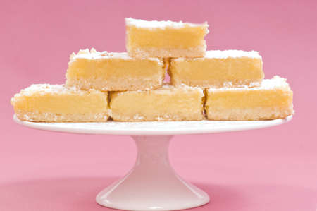 displayed: Delicious lemon squares displayed on a white cake stand