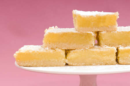 square: Delicious freshly baked lemon squares on a white cake stand Stock Photo