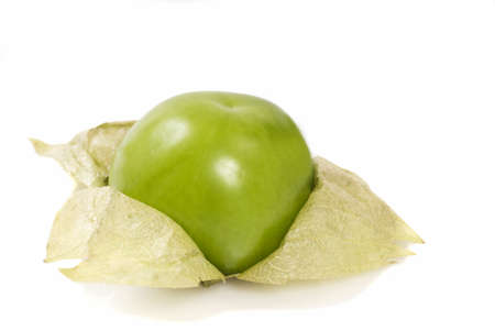 Three fresh tomatillos on a white background