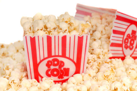 concession: Two boxes of delicious movie popcorn with popcorn spilling out Stock Photo