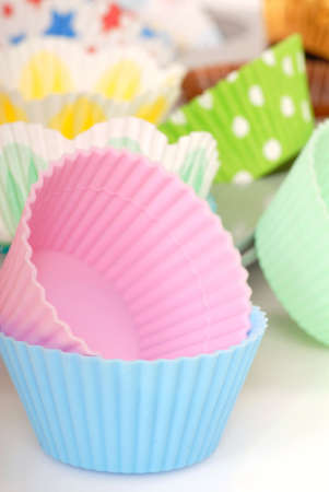 Variety of cupcake liners in different colors photo