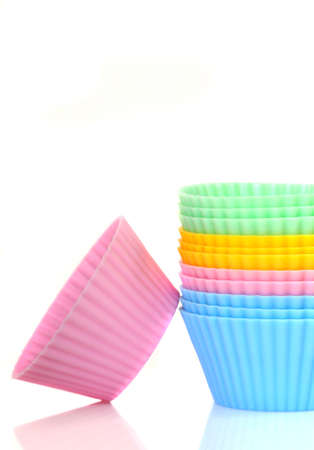 Stack of a variety of colorful cupcake liners photo