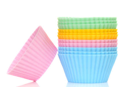 Stack of a variety of colorful cupcake liners in pastel colors photo