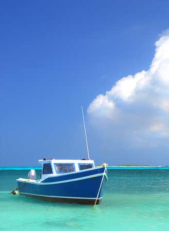 small boat: Fisherman
