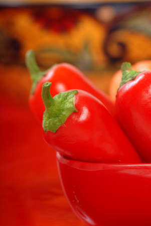 cazuela: Variety of colorful chili peppers on display in a Red Bowl