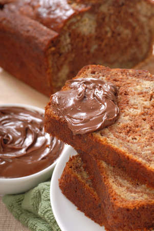 Freshly baked banana and chocolate nut bread with Nutella Stock Photo - 10498539