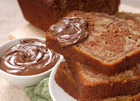 Freshly baked banana and chocolate nut bread with chocolate hazelnut spread