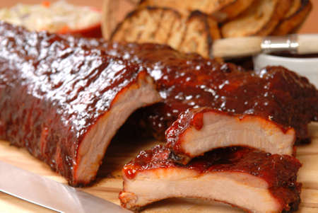 Delicious BBQ ribs with toasted bread, cole slaw and a tangy BBQ sauce Stock Photo - 10607020