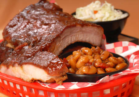 Delicious BBQ ribs with beans, cole slaw and a tangy BBQ sauce Stock Photo - 10607014