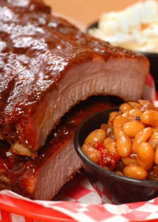 tangy: Delicious BBQ ribs with beans, cole slaw and a tangy BBQ sauce Stock Photo