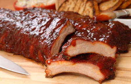 cookout: Delicious BBQ ribs with toasted bread, cole slaw and a tangy BBQ sause Stock Photo