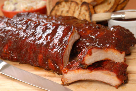 Delicious BBQ ribs with toasted bread, cole slaw and a tangy BBQ sause Stock Photo