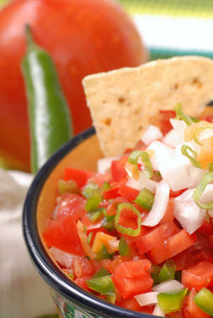tex mex: Fresh spicy salsa with tortilla chips along with the ingredients for the salsa