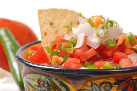 tex: Fresh spicy salsa with tortilla chips along with the ingredients for the salsa