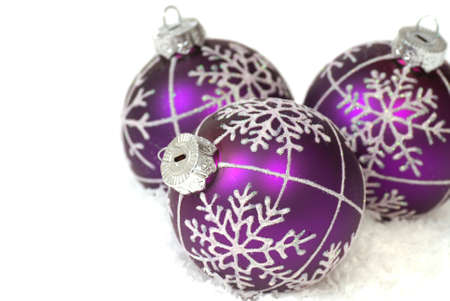 Festive purple Christmas ornaments on snowflakes Stock Photo