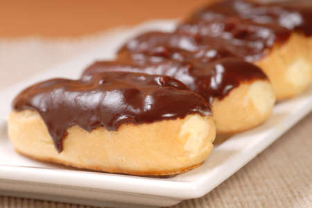 Delicious homemade eclairs with a chocolate ganache photo