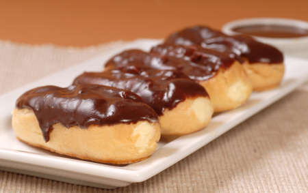 Delicious homemade eclairs with a chocolate ganache and dipping sauce