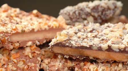 Different types of English Toffee with a variety of chocolates and nuts with a shallow depth of field