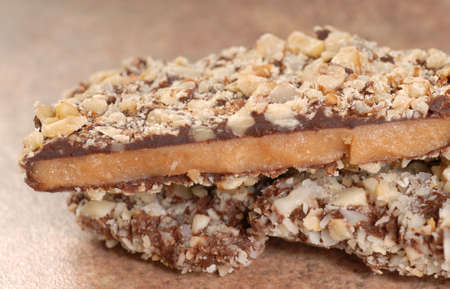 Delicious Dark Chocolate English Toffee with chopped pecan nuts Stock Photo - 14255923