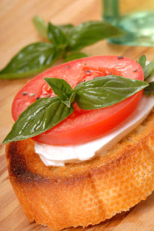 Delicious Bruschetta with tomato, mozzarella and basil  photo