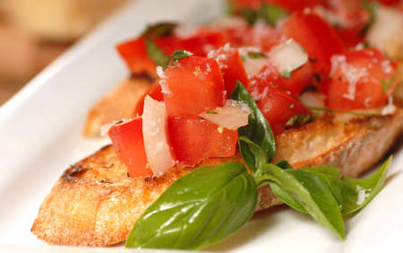 Delicious Bruschetta with tomato and basil on a white place  photo