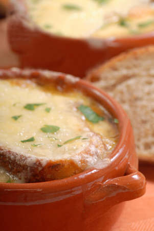 Delicious homemade French Onion Soup with crusty rye bread photo