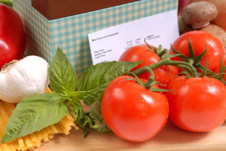 Recipe box and the ingredients for fresh spaghetti and sauce photo