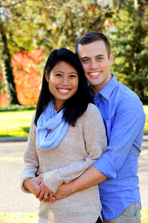 Young attractive couple in love in an autumn setting following their engagement Stock Photo