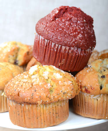 Variety of delicious breakfast muffins served on a platter Stock Photo