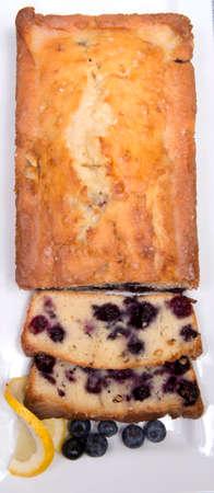 Freshly baked lemon blueberry bread sliced on a platter waiting to be served