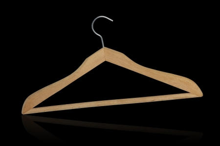 Wooden hanger isolated on black background Stock Photo - 17552684
