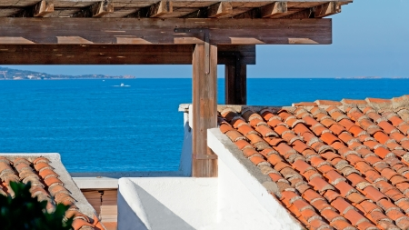 rotondo: wooden porch by the sea of Porto Rotondo
