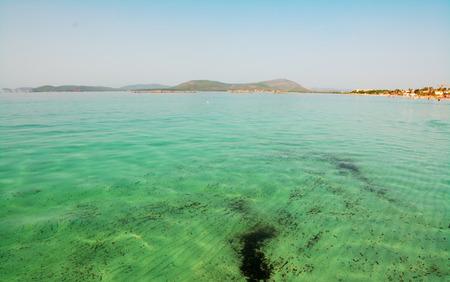 skim: clear water in Lido San Giovanni, Alghero Stock Photo