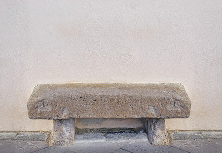 stone walls: stone bench in a beige wall Stock Photo