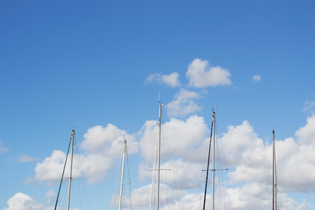 masts: boat masts under a cloudy sky Stock Photo