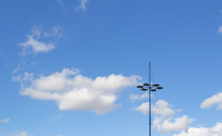 blue lamppost under a cloudy sky photo