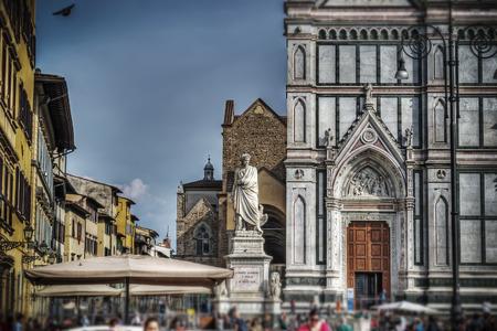 dante alighieri: Dante Alighieri statue and Santa Croce cathedral in Florence in tilt shift effect Stock Photo