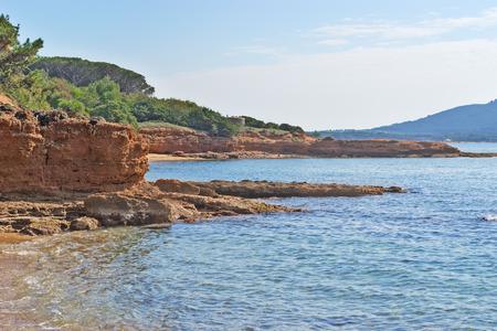 skim: red rocks and blue sea in Mugoni beach Stock Photo
