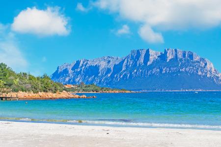skim: Tavolara seen from Porto Istana beach Stock Photo