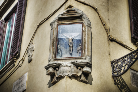 tabernacle: close up of a tabernacle crucifix on a wall in Florence Italy Stock Photo