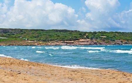 ferro: waves and yellow sand in Porto Ferro beach Stock Photo