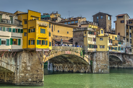 ponte vecchio: Ponte Vecchio under a cloudy sky in Florence Stock Photo