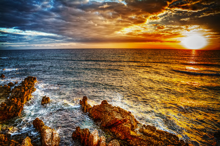 seascape: colorful sunset in Alghero, Sardinia Stock Photo