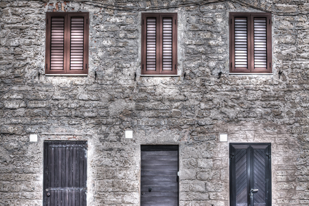 windows and doors: wooden doors and windows in Alghero old town, Sardinia