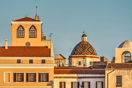or san michele: San Michele dome in Alghero at sunset
