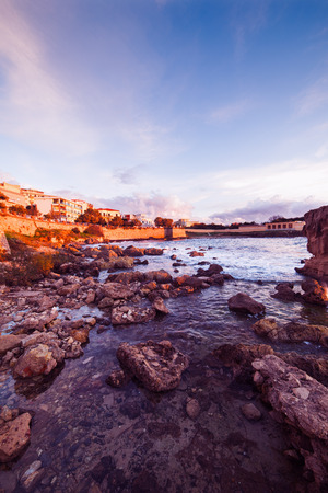 shorelines: rocks at dusk in Alghero coastline, Sardinia Stock Photo